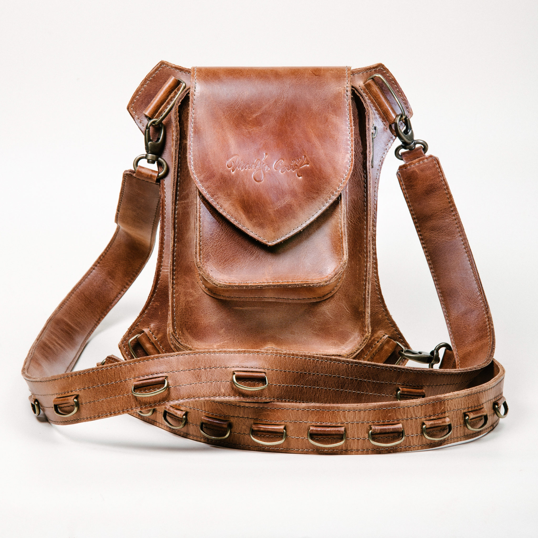 Brown multifunctional holster bag handcrafted by Maarja Sööt. Photo by Taavi Lutsar.